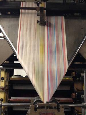Final Folding process after job leaves the main printing area at Florida Sun Printing